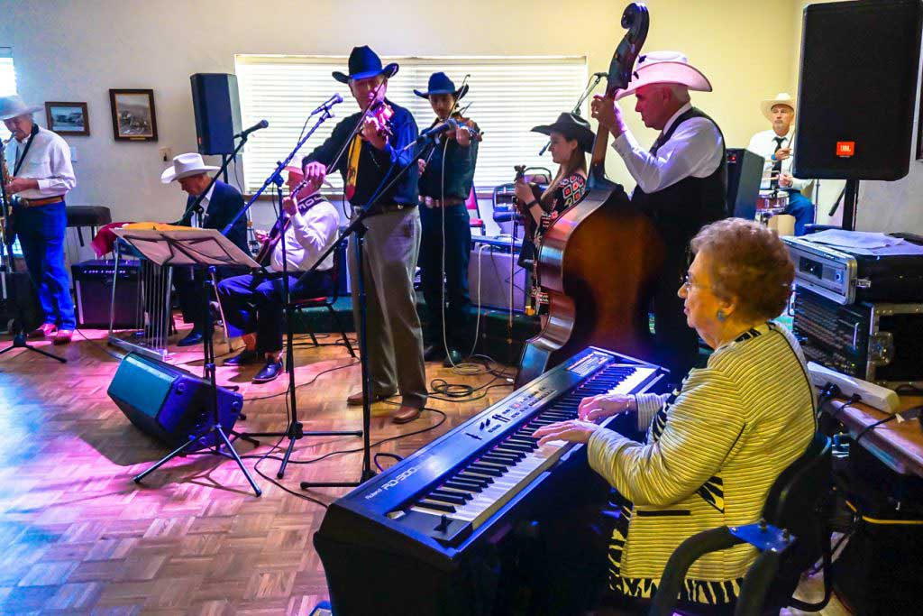 Band in cowboy hats playing instruments