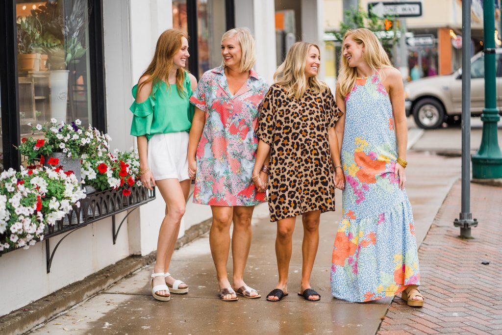 Four women on sidewalk shopping in Mineral Wells